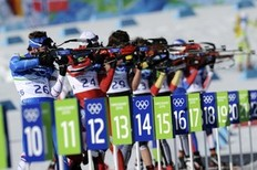 Competitors shoot in the men's Biathlon 15 km mass start final at the Whistler Olympic Park during the Vancouver Winter Olympics on February 21, 2010.