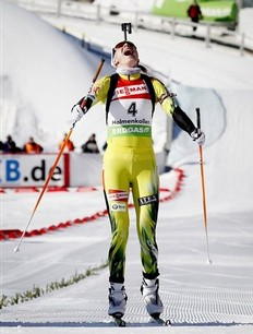 Anastasiya Kuzmina of Slovakia reacts as she crosses the finish line in the women's 10 km pursuit event in the International Biathlon Union (IBU) Biathlon World Cup in Oslo, Noway Saturday March 19, 2011.