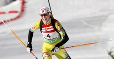 Slovakia's Anastasiya Kuzmina celebrates as she win the women's 10 km pursuit event of the IBU biathlon World Cup in Oslo, on March 19, 2011.