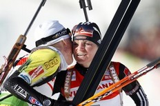 Slovakia's Anastasiya Kuzmina (L) and Germany's Andrea Henkel (R) congratulate each other after crossing the fisnish line in the women's 10 km pursuit event of the IBU biathlon World Cup in Oslo, on March 19, 2011.