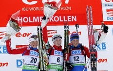 Russia's Anna Bogaliy-Titovets (L), Darya Domracheva of Belarus (C) and Russia's Olga Zaitseva (R) cheer on the podium after the women's 12.5 km mass start event of the IBU biathlon World Cup in Oslo, on March 20, 2011.