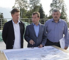 Russia's President Dmitry Medvedev (C), accompanied by Gazprom CEO Alexei Miller (L), visits a cross-country skiing and biathlon complex construction site built for the 2014 Winter Olympic Games in Sochi August 23, 2011.