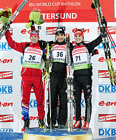 French Martin Fourcade (C) Stands On The Podium With Second-placed Czech Michal Slesingr (...