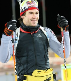 OSTERSUND, SWEDEN - DECEMBER 01: Michael Roesch of Germany smiles after a training session ahead of the E.ON Ruhrgas IBU Biathlon World Cup on December 1, 2009 in Ostersund, Sweden.
