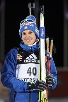 OSTERSUND, SWEDEN - DECEMBER 02: Michaela Ponza of Italy poses during the flower ceremony after she reaches the seventh place in Women's 15 km Individual event of the E.ON Ruhrgas IBU Biathlon World Cup on December 2, 2009 in Ostersund, Sweden.