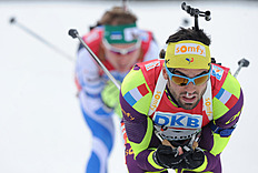 France's Simon Fourcade (R) Competes