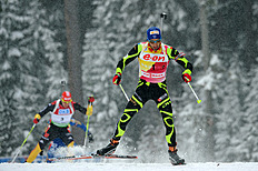 Germany's Arnd Peiffer (L) And France's Martin Fourcade Compete In The Men's 12.5 Km Pursu...