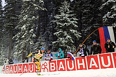 Germany's Magdalena Neuner (L) Competes