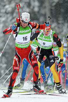 Germany's Arnd Peiffer (R) Competes
