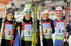 France's team Marie Laure Brundet (L-R), Sylvie Becaert, Marin Dorin, Sandrine Bailly celebrate after the women's 4x6 km relay at the Biathlon World Cup in Ostersund December 6, 2009. Germany won the relay, Russia finished second and France finished third.