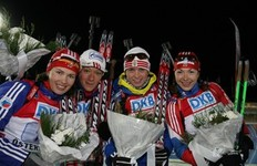 OSTERSUND, SWEDEN — DECEMBER 06: (L-R) second place: Russia with Olga Medvedtseva, Olga Zaitseva, Svetlana Sleptsova and Anna Boulygina of Russia after the Women's 4x6 km Relay in the E.ON Ruhrgas IBU Biathlon World Cup on December 6, 2009 in Ostersund, Sweden.