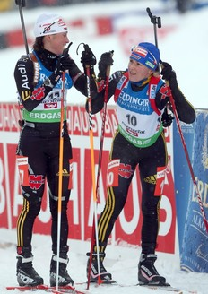 HOCHFILZEN, AUSTRIA - DECEMBER 12: Andrea Henkel of Germany speaks with team mate Martina Beck after the Women's 10 km Pursuit in the IBU Biathlon World Cup on December 12, 2009 in Hochfilzen, Austria.