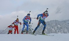 HOCHFILZEN, AUSTRIA — DECEMBER 12: Simon Fourcade of France leads Maxim Tchoudov of Russia and Christoph Sumann of Austria during the men's 12.5km pursuit on December 12, 2009 in Hochfilzen, Austria.