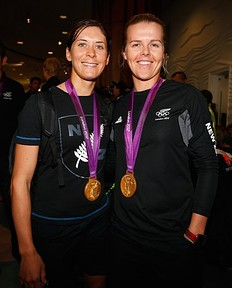 AUCKLAND, NEW ZEALAND — AUGUST 15: Sailers Jo Aleh (L) and Polly Powrie of the New Zealand Olympic team arrive at Auckland International Airport with their gold medal after competing in the 2012 London Olympic Games on August 15, 2012 in Auckland, New Zealand.