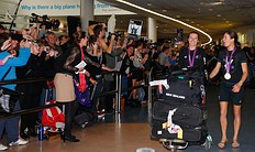 AUCKLAND, NEW ZEALAND � AUGUST 15: Gold medalists Sailors Polly Powrie (L) and Jo Aleh of the New Zealand Olympic team are welcomed home at Auckland International Airport with their gold medal after competing in the 2012 London Olympic Games on August 15, 2012 in Auckland, New Zealand.