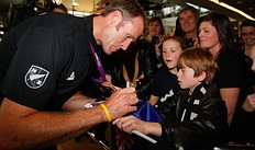 AUCKLAND, NEW ZEALAND � AUGUST 15: Rower Mahe Drysdale of the New Zealand Olympic team signs his autograph for young fans at Auckland International Airport after competing in the 2012 London Olympic Games on August 15, 2012 in Auckland, New Zealand.