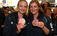 AUCKLAND, NEW ZEALAND — AUGUST 15: Rebecca Scown and Juliette Haigh (L) of the New Zealand Olympic team display their Bronze Medals after arriving at Auckland International Airport after competing in the 2012 London Olympic Games on August 15, 2012 in Auckland, New Zealand.