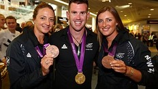 AUCKLAND, NEW ZEALAND — AUGUST 15: (L-R) Juliette Haigh, Nathan Cohen and Rebecca Scown of the New Zealand Olympic team display their Olympic medals after arriving at Auckland International Airport after competing in the 2012 London Olympic Games on August 15, 2012 in Auckland, New Zealand.