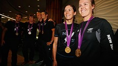 AUCKLAND, NEW ZEALAND — AUGUST 15: Sailers Jo Aleh and Polly Powrie (R) of the New Zealand Olympic team arrive at Auckland International Airport with their gold medal after competing in the 2012 London Olympic Games on August 15, 2012 in Auckland, New Zealand.