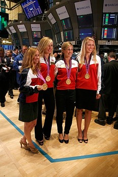 NEW YORK, NY — AUGUST 15: (L to R) U.S. Olympic gold medalists in Women's Rowing Mary Whipple, Meghan Musnicki, Erin Cafaro and Esther Lofgren ring the opening bell at the New York Stock Exchange on August 15, 2012 in New York City.