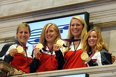 NEW YORK, NY — AUGUST 15: (L to R) U.S. Olympic gold medalists in Women's Rowing Erin Cafaro, Meghan Musnicki, Esther Lofgren and Mary Whipple ring the opening bell at the New York Stock Exchange on August 15, 2012 in New York City.