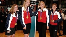 NEW YORK, NY — AUGUST 15: (L to R) U.S. Olympic gold medalists in Women's Rowing Mary Whipple, Esther Lofgren, Meghan Musnicki and Erin Cafaro ring the opening bell at the New York Stock Exchange on August 15, 2012 in New York City.