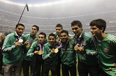 Mexico's Olympic gold medallist soccer team poses for a picture during a tribute for them at Azteca stadium in Mexico City August 15, 2012. Mexico beat Brazil in the men's soccer final gold medal match on August 11 at the London 2012 Olympic Games.