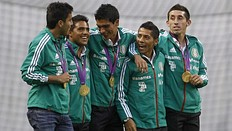 Mexico's Olympic gold medalist soccer players show their medals during a tribute at Azteca stadium in Mexico City, August 15, 2012. Mexico beat Brazil in their men's soccer final gold medal match on August 11, 2012 at the London 2012 Olympic Games.