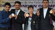 Indian London Olympic 2012 medal winners (L-R) wrestler Sushil Kumar, shooter Vijay Kumar, boxer Mary Kom,and shooter Gagan Narang display their medals during a felicitation ceremony in New Delhi on August 16, 2012. India collected six medals and no golds at the Olympics, saying that the modest haul was a record and efforts were already under way to improve.