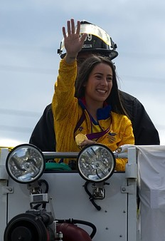 The London 2012 Olympic Games Colombian gold medalist in the women's BMX event Mariana Pajon, waves to fans from atop a firefighters truck, in a street in Medellin, Antioquia department, Colombia, on August 16, 2012. Colombia won one gold, three silver and four bronze medals in the London 2012 Olympic Games.