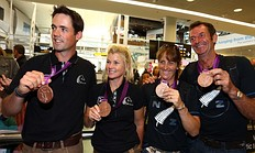 AUCKLAND, NEW ZEALAND — AUGUST 21: L_R: Jonathon Paget, Jonelle Richards, Caroline Powell and Mark Todd of the New Zealand Olympic Equestrian team pose for a photo arrives home after competing in the London 2012 Olympic Games, at Auckland Airport on August 21, 2012 in Auckland, New Zealand.