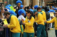 Australian Olympians sign autographs for spectators as the Australian Olympic team was officially welcomed home from the 2012 London Olympic Games with a colourful street parade through Sydney on August 20, 2012. Australia finished 10th on the medal table, a slump from its performance in Beijing where it claimed 6th position, leading to a rush of criticism that the team underperformed.