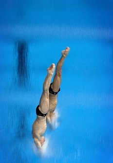 Russia's Illya Zakharov and Victor Minibaev compete during the men's synchronised 10m platform Preliminary event at the FINA Diving World Cup, also doubling as a 2012 Olympics Test event, at the Olympic Aquatic Centre in east London, on February 23, 2012.