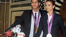 Olympic silver medalist Habiba Ghribi (R) and Olympic champion, swimmer Oussama Mellouli (L) give a press conference in Tunis on August 21, 2012. Habiba Ghribi won silver medal in the 3000m steeplechase while Oussama Mellouli won the men's 10km swimming marathon during the London 2012 Olympic Games.