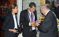 Tunisian Prime Minister Hamadi Jebali (R) meets Olympic silver medalist Habiba Ghribi (L) and Olympic champion, swimmer Oussama Mellouli (C), in Tunis on August 21, 2012. Habiba Ghribi won silver medal in the 3000m steeplechase while Oussama Mellouli won the men's 10km swimming marathon during the London 2012 Olympic Games.