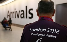 LONDON, ENGLAND — AUGUST 22: A London 2012 Paralympic games volunteer waits for athletes to arrive at Heathrow's Terminal Four on August 22, 2012 in London, England. The London 2012 Paralympic Games open on August 29, 2012 for 12 days.