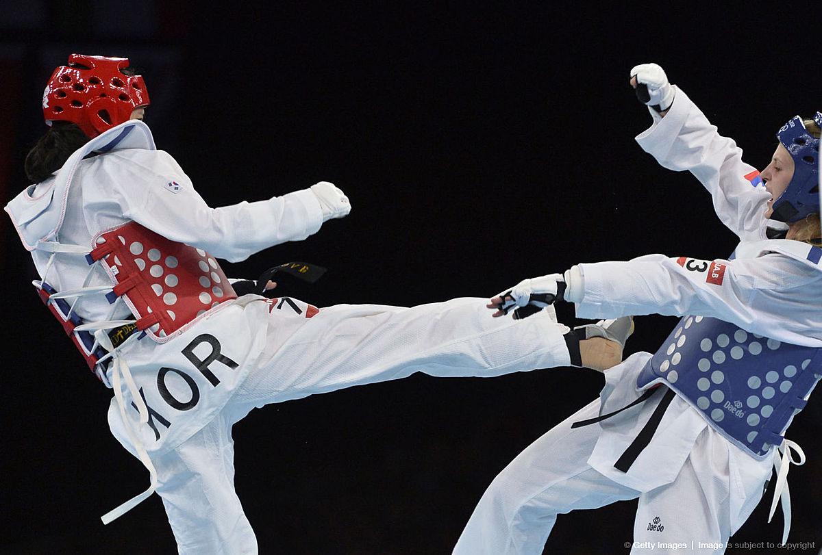 Тхэквондо (таэквондо, taekwondo): Russia's Anastasiia Baryshnikova (blue) биатлон фото смотреть